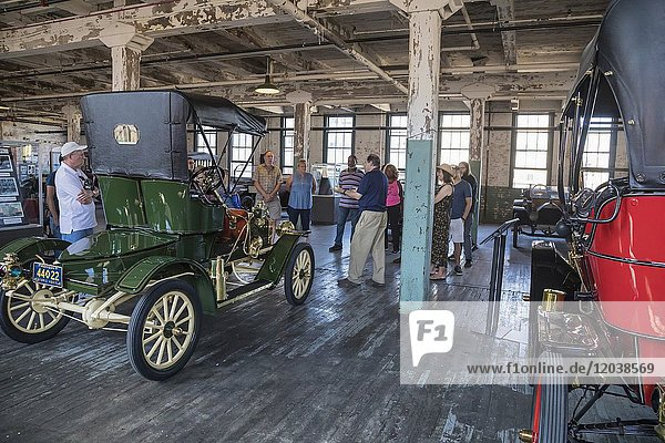 Detroit  Michigan - Visitors tour the Ford Piquette Avenue Plant  where the first Ford Model T was built in 1908. At left is a 1907 Ford Model S Runabout  on the right is a 1909 Model T Touring car. The Piquette plant is now a museum which houses many Model T's.