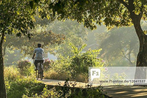 Cyclist at Kan Thar Yar See  Hpa-an  Myanmar  Asia