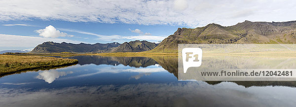 Panoramic view of mountains and blue sky reflecting in lake  near Vik  South Iceland  Polar Regions