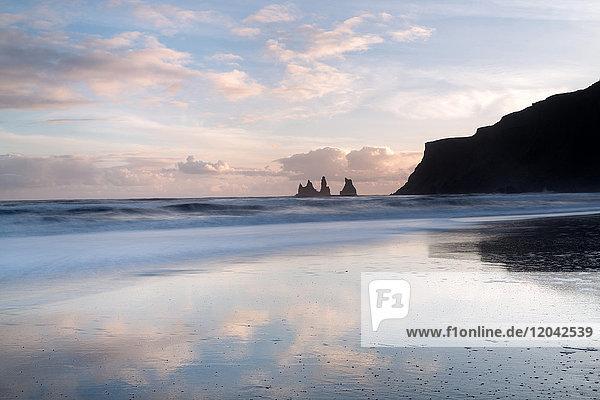 Rock stacks of Reynisfjara  captured from beach at Vik Y Myrdal at sunset  South Iceland  Polar Regions