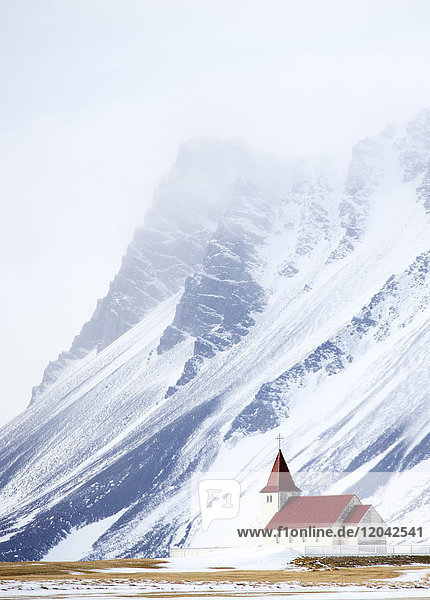 Church against snow covered mountains  winter afternoon  Snaefellsnes Peninsula  Iceland  Polar Regions
