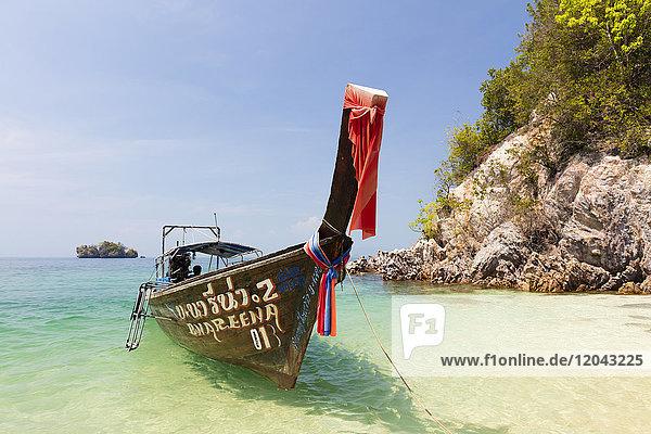 Longtail boat and limestone cliffs  Koh Pakbia  Koh Hong Islands  Ao Nang  Krabi  Thailand  Southeast Asia  Asia