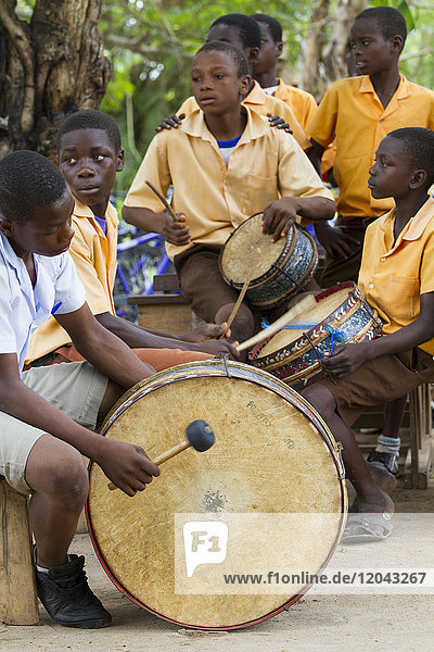 A group of young men playing the drums in Ghana  West Africa  Africa
