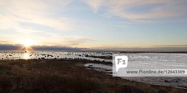Sunrise over the semi-frozen Hudson Bay in northern Manitoba  Canada  North America