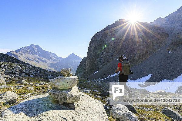 Hiker on the trail to Lej Lagrev  St. Moritz  Engadine  Canton of Graubunden  Switzerland  Europe