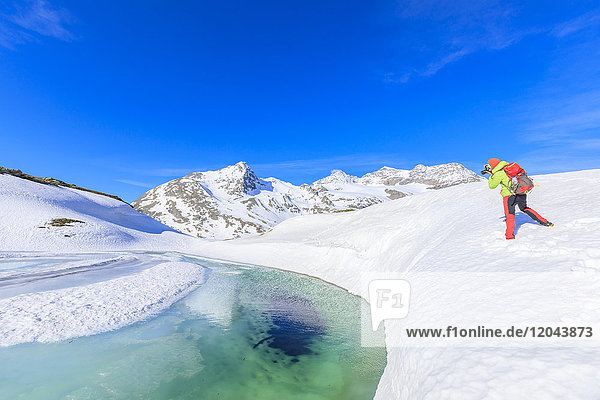 Photographer at the Bernina Pass during the spring thaw  St Moritz  Upper Engadine  Canton of Graubunden  Switzerland  Europe
