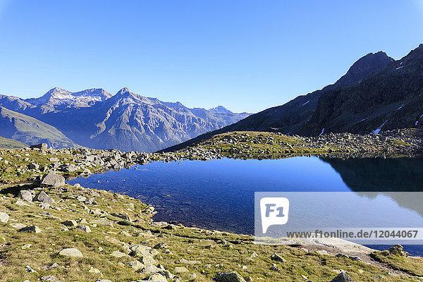 Lake Bergsee at sunrise  Chiavenna Valley  Spluga Valley  Spluga Pass  province of Sondrio  Valtellina  Lombardy  Italy  Europe