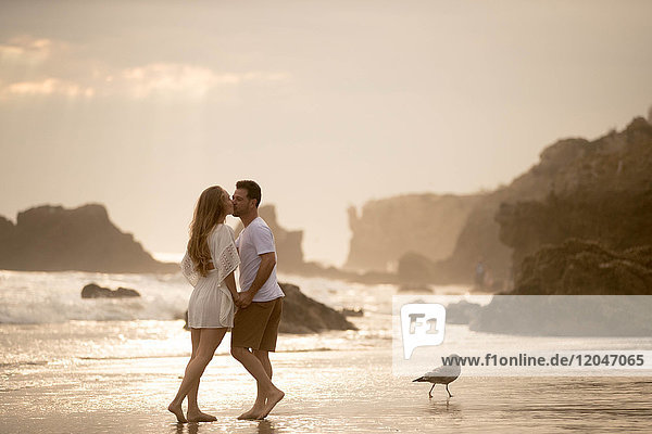 Romantic couple on beach  Malibu  California  US