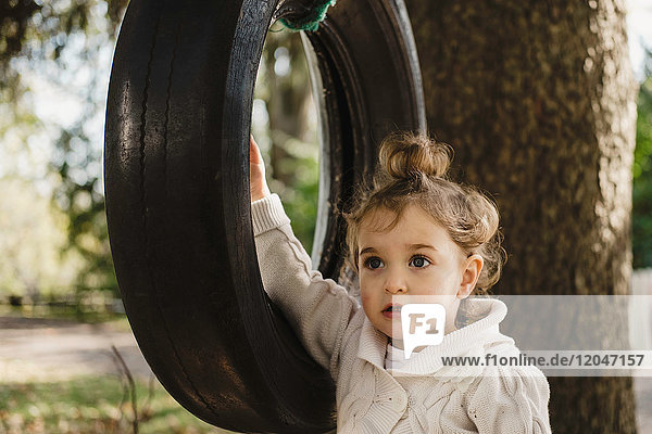 Girl on tyre swing