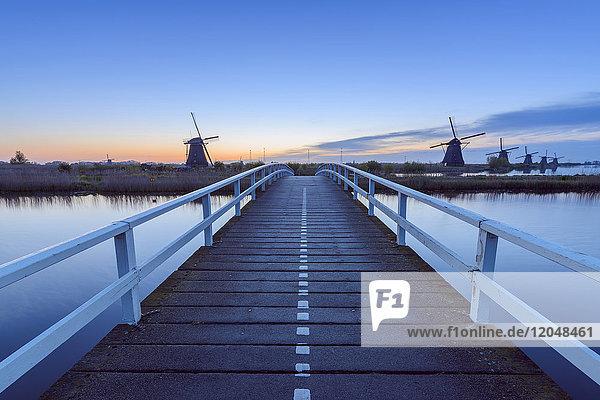 Wooden Bridge with Windmills at Dawn  Kinderdijk  South Holland  Netherlands