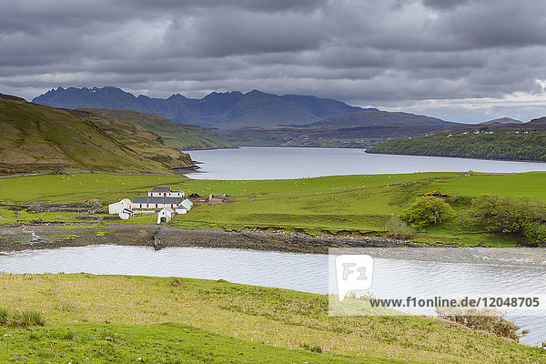 Scottish coast with farm in the village of Dunvegan on the Isle of Skye in Scotland  United Kingdom