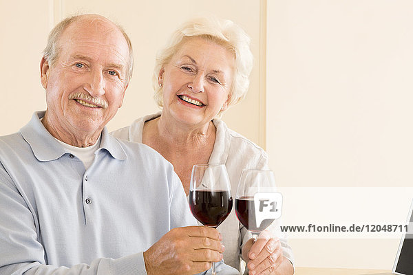 Portrait of Couple with Red Wine