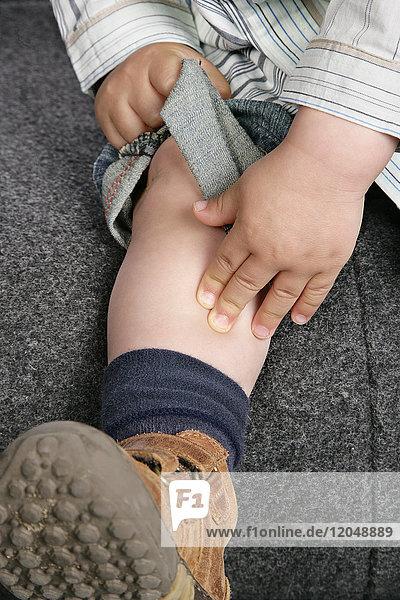 Child Touching Leg