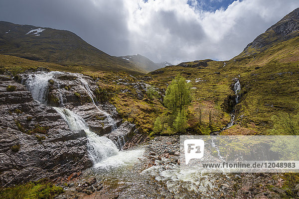 Waterfall in the Scottish Highlands with cloudy sky in Scotland  United Kingdom