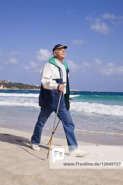 Man Nordic Walking on the Beach