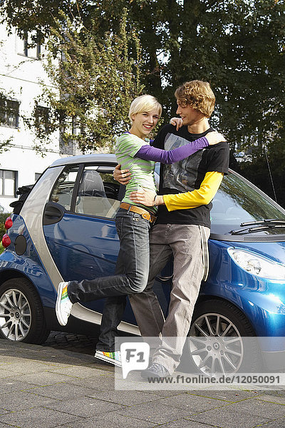 Portrait of Couple Standing by Car