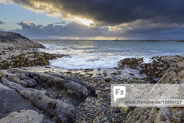 Surf along the Scottish coast at sunrise in spring at Mallaig in Scotland  United Kingdom