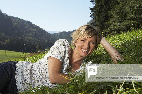 Woman Lying in Meadow