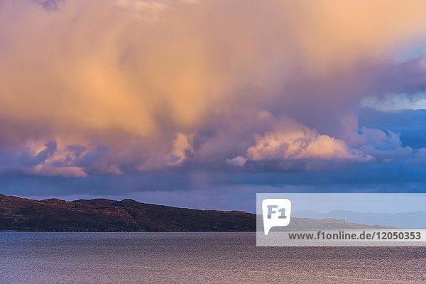 Cloud formations at sunset over the ocean at the Isle of Skye in Scotland,  United Kingdom