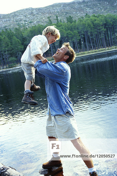Father and Son by Lake