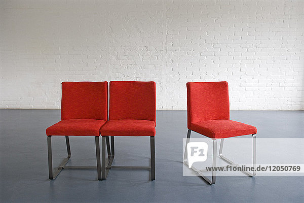 Red Chairs against Wall