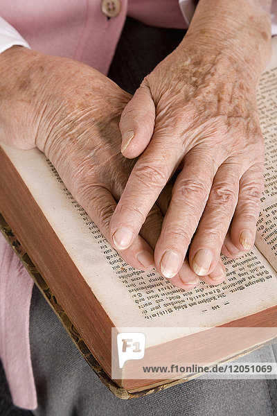 Woman's Hands on Book