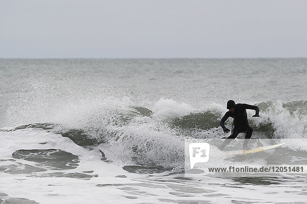 Person Surfing In The Pacific Ocean Near Yakutat  Southeast Alaska  USA