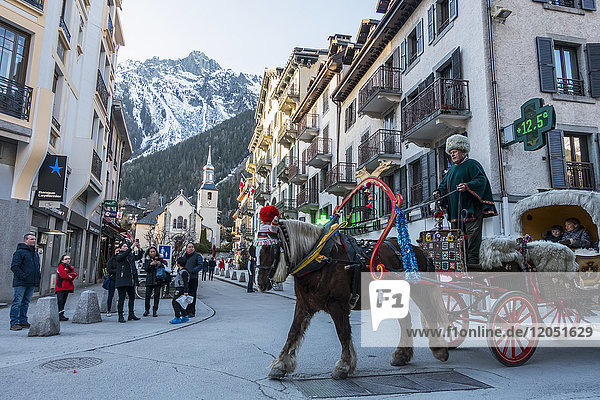 Tourists Ride In A Buggy Pulled By A Horse Through The Streets; Chamonix  France