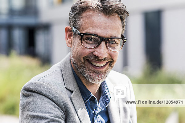 Portrait of smiling businessman with glasses