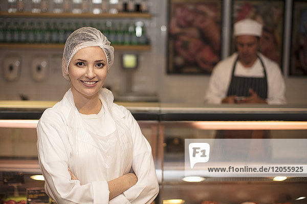 Portrait of smiling woman in butchery