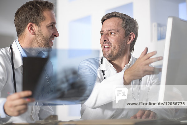 Two doctors discussing x-ray image