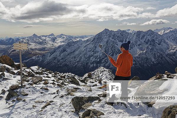 Austria  Tyrol  Oetztal  Soelden  woman with selfie stick at Gaislachkogel