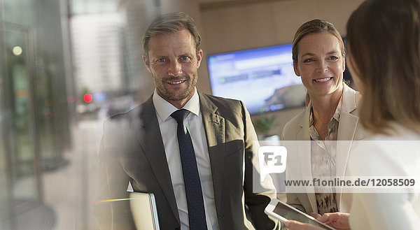 Portrait smiling businessman with businesswomen in office