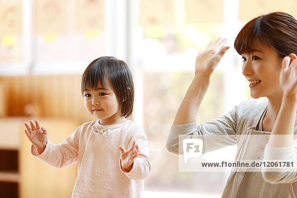 Teacher with kid at Japanese kindergarten