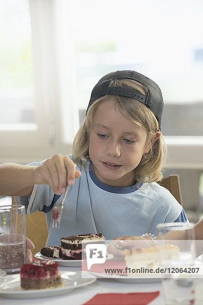 Boy Eating Cake at home
