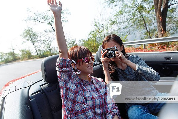 Young people travel by car