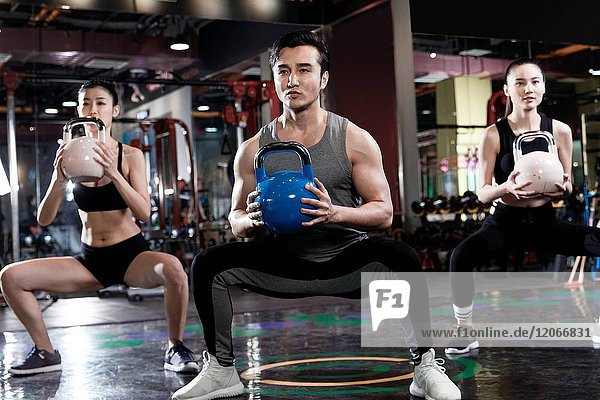 Young people exercise at the gym