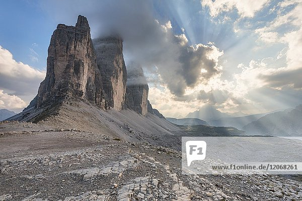 Sunset with clouds on Tre Cime di Lavaredo as seen from Lavaredo fork  Sexten Dolomites  Italy.