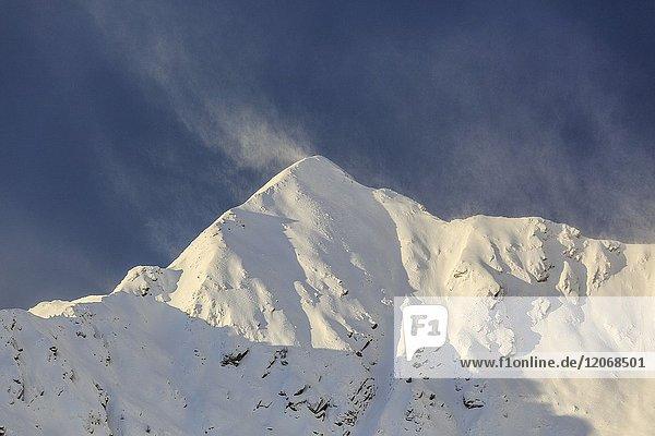 Wind on the snowy peak of Monte Rosetta  Gerola Valley  Sondrio province  Valtellina  Lombardy  Italy.