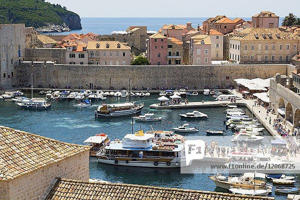 Dubrovnik  Dubrovnik-Neretva County  Croatia. Boats in the Old Port. The old city of Dubrovnik is a UNESCO World Heritage Site.