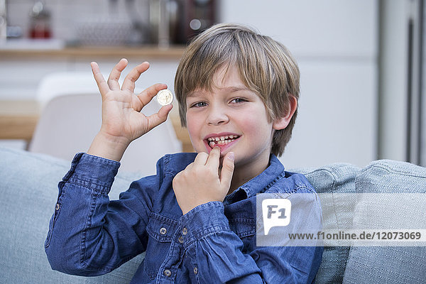 A child who has lost a tooth.