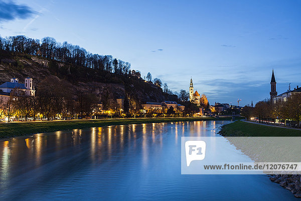 Austria  Salzburg  River and illuminated riverbank at dusk