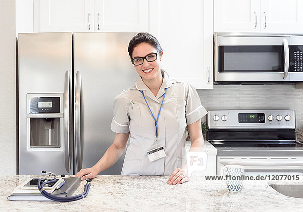 Caucasian nurse posing in kitchen