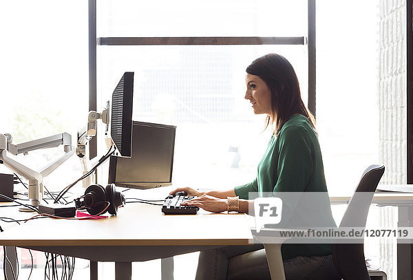 Caucasian woman using computer in office