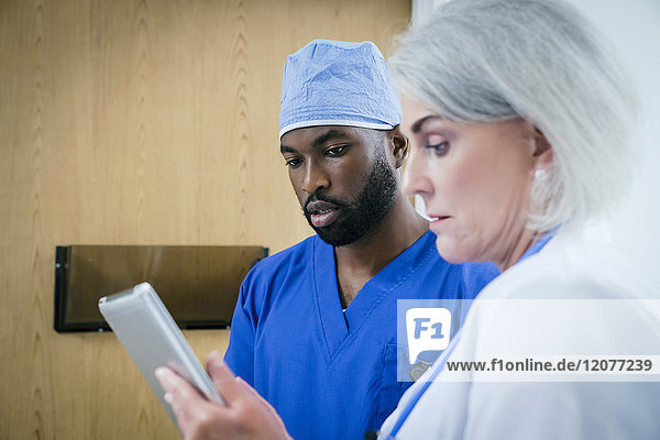 Doctor and nurse discussing digital tablet