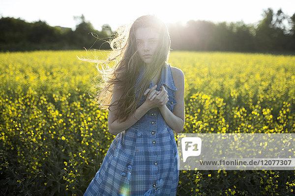 Portrait of Caucasian woman standing in windy field