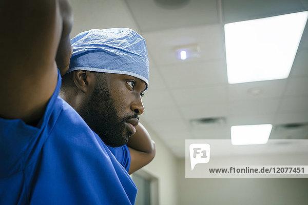Black doctor wearing surgical cap