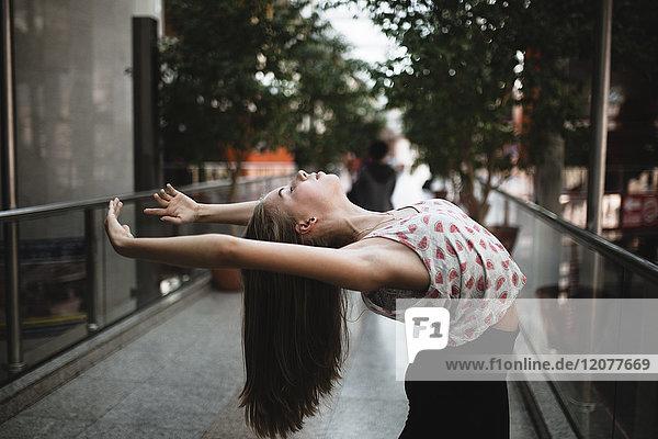 Caucasian woman dancing outdoors, Caucasian woman dancing outdoors