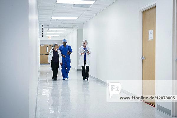 Doctors and nurse walking in hospital