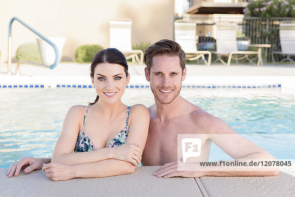 Portrait of Caucasian couple in swimming pool